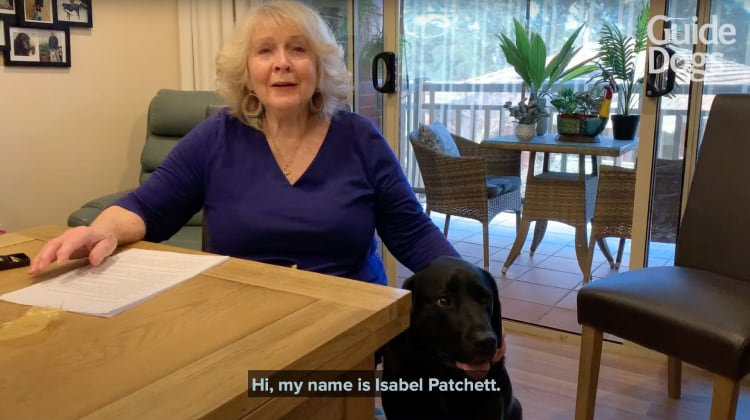 A YouTube Thumbnail showing Isabel Patchett and Galen the black Labrador