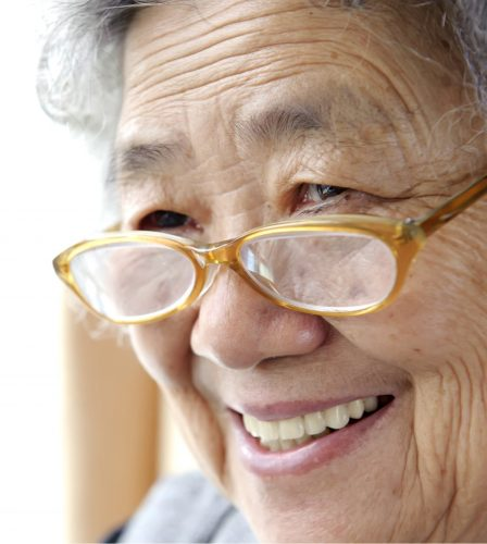 A close up of an older adult person who is smiling.
